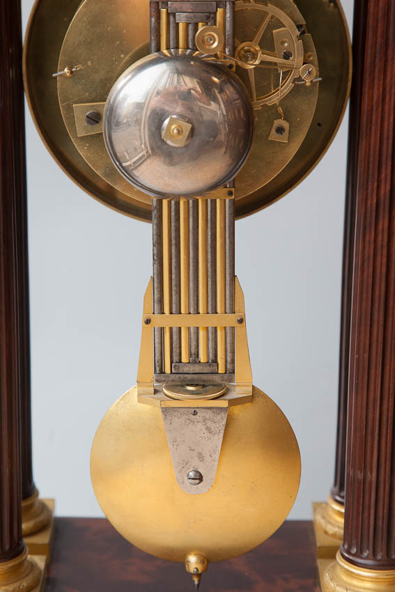steel and gilt bronze graduated movement on early 19th century portico clock